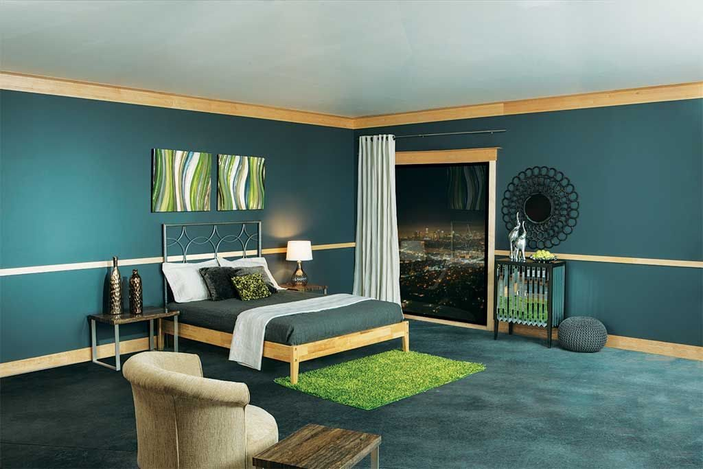 Green bedroom with Ferche molding on walls and baseboards