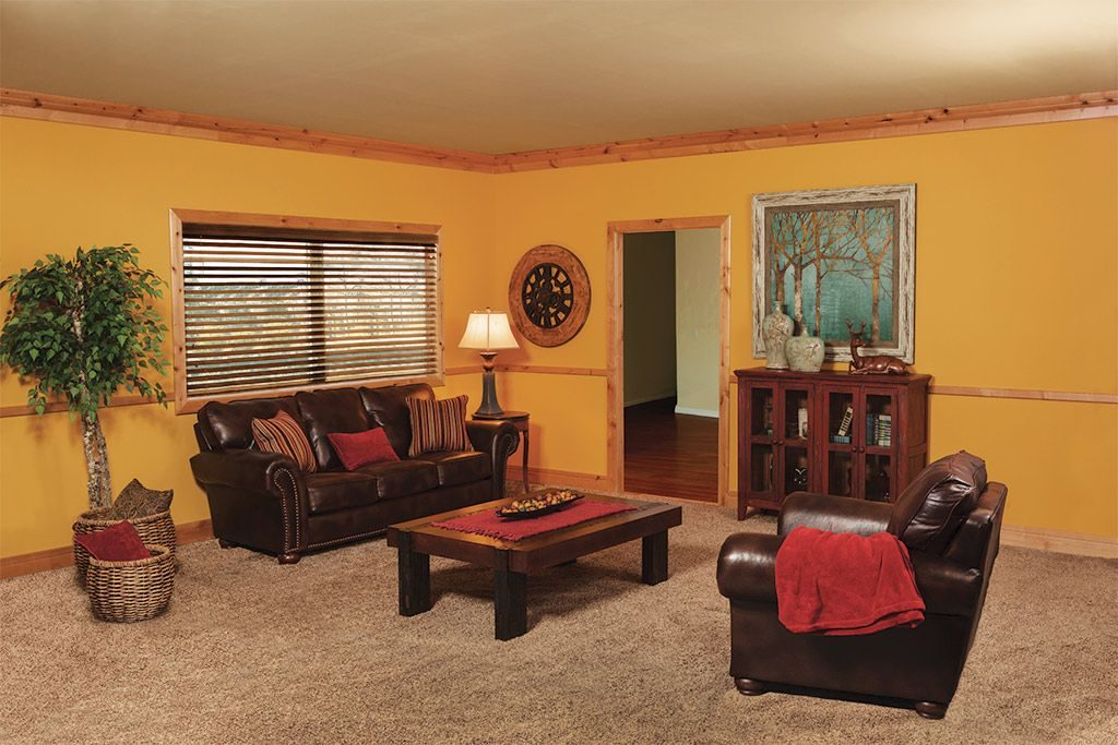 Orange and brown room with natural Ferche molding on walls